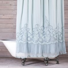 The Caprice Shower Curtain from Pom Pom at Home combines a romantic and vintage style. This shower curtain feature a handmade design with floral lace and netting details.