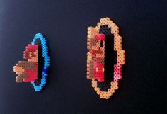Mario vs Portal - 3-D beads. $25.00, via Etsy.
