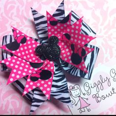 Cute, cute, cute Zebra Minnie Mouse Hairbow! Can be found at Giggly Girl Bowtique on Facebook!