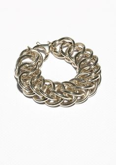 Lend+your+look+som+edge+with+this+chunky+chain+bracelet,+crafted+from+a+blend+of+steel+and+brass.