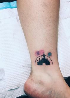 Disney Magic Kingdom Ankle Tattoo by Lauren Winzer