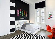 Fascinating black and white boy teenage bedroom ideas skateboard on wall striped carpet design darkwood floor red learning desk