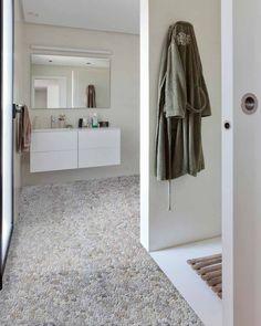 Pebble tiled bathroo