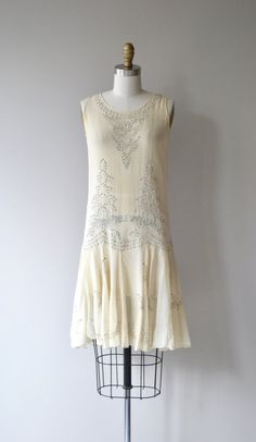 Antique 1920s cream silk chiffon dress with prongset rhinestones in elaborate pattern on both the bodice and the skirt. Slips over the head with no closures and is sheer. --- M E A S U R E M E N T S ---  fits like: xs bust: 32 waist: up to 30 hip: up to 36 length: 37 brand/maker: n/a condition: excellent  ★ layaway is available for this item  To ensure a good fit, please read the sizing guide: http://www.etsy.com/shop/DearGolden/policy  ✩ more vintage dresse...