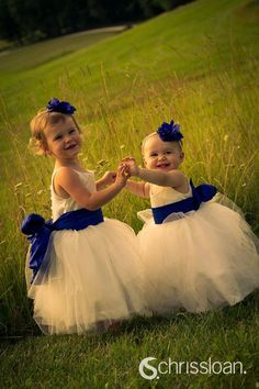 Love the whole look for flower girl for wedding with blue brides maid's dresses.