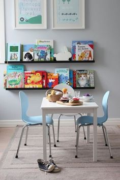 "Children's playroom ideas...... ""These look alot like the Felix chair by Land of Nod, which I like.  Also like the books on display."" -nicole"