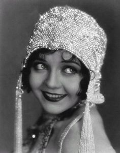 1920's -- The hat is almost as adorable as her smile! And those eyes... :D