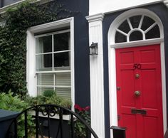 Complementary contrasting paint colors. Navy exterior with red door. Inspiration for front door. London, England.