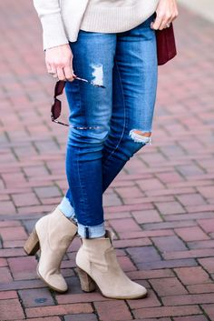 How to Wear Ankle Boots -- Cuff your ankle skinny jeans.