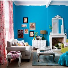 Gallery wall in Caribbean blue living room, love the paint treatment where the wall and ceiling meet. Photobucket