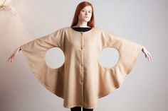 Ladybird coat. Natural camel hair coat lined in black silk, trimmed with grosgrain silk.