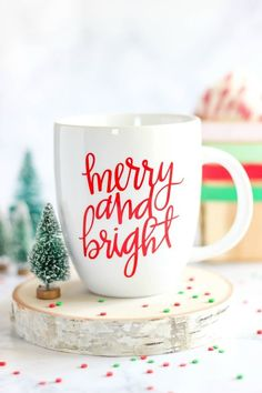 Merry and Bright Vinyl Mug Enjoy the holiday season with a DIY Merry and Bright Vinyl Mug. It's perfect for sipping a cup of coffee or hot chocolate on a cold winter day. It makes a great gift idea too!Bright Bright may refer to: Diy Christmas Mugs, Christmas Vinyl, Christmas Coffee, All Things Christmas, Christmas Holidays, Xmas, Christmas Nails, Christmas Decorations, Mug Noel