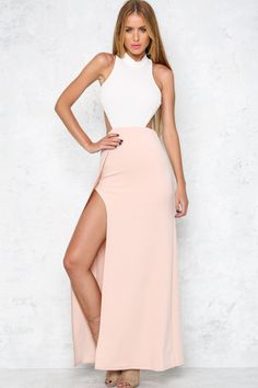 Steal their hearts in our Lovers Lane Maxi Dress! This two tone piece is made from a mid weight fabric. The high neck top has a three button closure and thin straps joining to a low cut back. With an elasticated waist for a figure accentuating fit, there is an exposed back zip and a cut away side for showing a little leg. Just add a matching white lace up heel and a blush box clutch! Dress. Not lined. Cold hand wash only. Model is standard XS and is wearing XS. True to size. Stretchy…