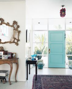 Paint the front door a happy hue like turquoise, sun yellow or bright red for an inviting entrance to the home | domino.com