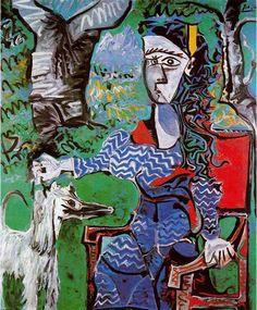 Mujer con perro debajo de un árbol.