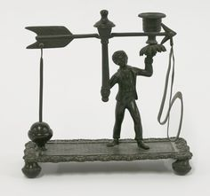 A pair of cast postal scales, modelled as a boy holding a candle sconce £100-150 17th June 2015