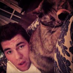 Tom Wilson with a cat