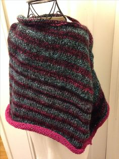 A poncho made from Jirza yarn that came in a Mary Maxim cushion kit.