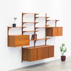 For sale: Wall unit by Poul Cadovius for Cado, Mid Century Modern Kitchen, Mid Century Modern Living Room, Wall Shelf Unit, Wall Storage Units, Mid Century Wall Unit, Living Room Furniture, Living Room Decor, Danish Modern Furniture, Midcentury Modern