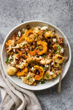This Harissa Roasted Cauliflower with Delicata Squash & Chickpeas is a healthy, gluten-free weeknight dinner! Made with just 7 ingredients!