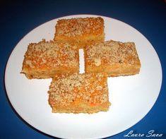 Aceasta prajitura cu morcovi este minunata!!!. Cu interior umed si fraged, si crusta crocanta de aluat, este mai mult decat o simpla prajitura de post. E una dintre cele mai bune prajituri de post pe care le-am incercat!!! O puteti face si fara crusta, cum am facut-o eu prima data acum muuulti ani :D, adica prin 2007, pe la inceputul blogului. Atunci am turnat intreaga compozitie in tava si am copt-o asa. Foooarte buna in ambele variante!!! Ingrediente: Pentru aluat: - 200 ml. ulei (3/4 ... Romanian Desserts, Cornbread, Sweet Treats, Mai, Ethnic Recipes, Food, Millet Bread, Sweets, Candy