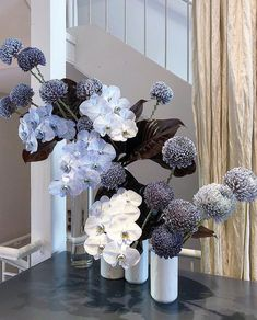White, dusy blue and lavendar orchids and jumbo chrysanthamums. Modern Floral Arrangements, Floral Centerpieces, Table Flowers, Flower Vases, Arreglos Ikebana, Floral Wedding, Wedding Flowers, Wedding Dresses, Hotel Flowers