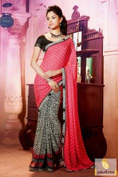 The black and pink braso georgette festival printed saree is made up of nice dot printed work and black print work with nice and beautiful lace patti work.