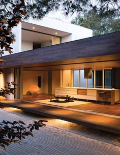 """This Carlsbad home has a tertiary space that space is known in traditional Japanese homes as the """"engawa."""" To sustain a unified look throughout, the floor and ceiling are clad in ipe wood. Phttp://www.dwell.com/house-tours/article/house-week-secret-fortress-next-door"""
