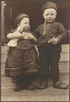 Ellis Island Portraits 1905-1920 (c1905)  Dutch siblings from the Island of Marken, holding religious tracts