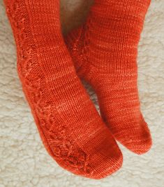 Spring Ecstasy Socks are worked toe up. Charts are provided for the budding vine cabling as well as for the heel.