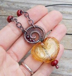 Kerri Fuhr Lampwork, Copper, Garnet  Leather | Flickr - Photo Sharing!