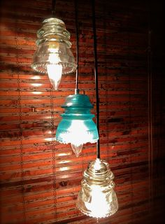 pendant lights made from Hemingray clear and blue glass insulators from the early 1900s