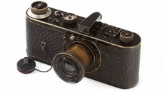 Leica - World's Most Expensive Camera This beautiful vintage camera is currently the world's most expensive camera. The WestLicht camera auction in Vienna on Saturday sets. Leica Camera, Camera Gear, Expensive Camera, Most Expensive, Antique Cameras, Vintage Cameras, Leica Appareil Photo, Classic Camera, Photography Camera