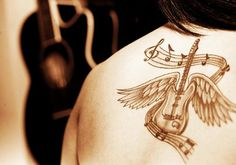 Guitar Tattoo Designs and Ideas for Men and Women6