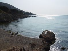 Beyond Anavissos and the fish restaurants are a few small rocky coves and sandy beaches.