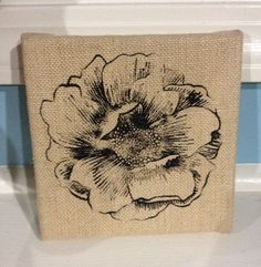 Flower screen printed on a burlap frame by 3sisterscreating