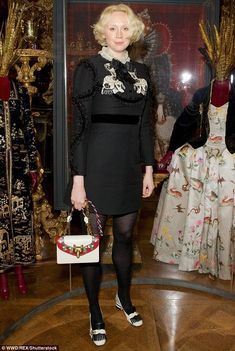 Dressed to impress: The actress cut a glamorous figure in a sophisticate black dress and m...
