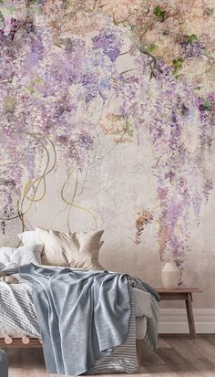 Create a beautiful purple bedroom with this Concrete Florals wallpaper from Wallsauce.com! Lilac is so on-trend right now, so why not create a gorgeous purple feature wall that celebrates this stylish colour scheme. Opt for a minimal bed with no headboard and style with pastel blue and pastel pink bedding. Choose light wooden bedside tables and floorboards and paint surrounding walls in white for a bright and trendy room. Get the look at Wallsauce.com!