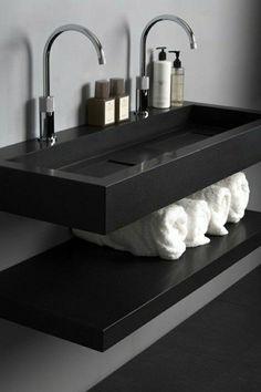 double lavabo et vasque en noir avec meuble sous-vasque avec serviettes rangees