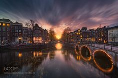 Amsterdam - When the sunset lines up exactly with these arcs its always a great time to shoot. Especially with clouds in the right direction.   I'm doing a 3-day workshop in Amsterdam in October with the great Daniel Cheong and Dany Eid. Check website for more info or email me at info@albertdros.com