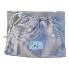 A waterproof, draw-string bag, which can hold at least 2 wet nappies.