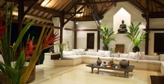 Stunning living room with a blend of modern minimalistic and traditional Indian style of design.