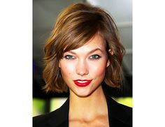 @Byrdie Beauty - Side bangs that hit near the temple accentuate cheekbones and balance a heart shaped face.