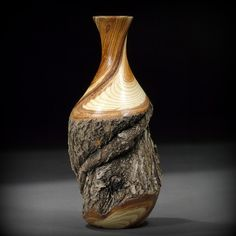 This is an absolutely gorgeous piece! I love the contrast between the precisely turned section with the natural bark. Share your woodturning pieces with us at facebook.com/NOVAwoodworking and also follow us on Instagram @novawoodworking