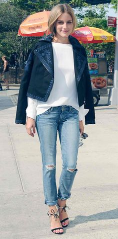 Olivia Palermo dressed up her destroyed denim with an optic white long-sleeve blouse, a blue embroidered moto-style Marchesa Voyage for ShopStyle jacket (draped over her shoulders), and ankle-tie sandals from her Aquazzura collection.