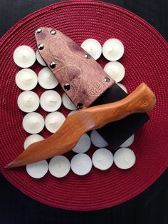 Yew wax play knife and leather sheath, with appaloosa finish and rope motif www.alexanderspaddles.com