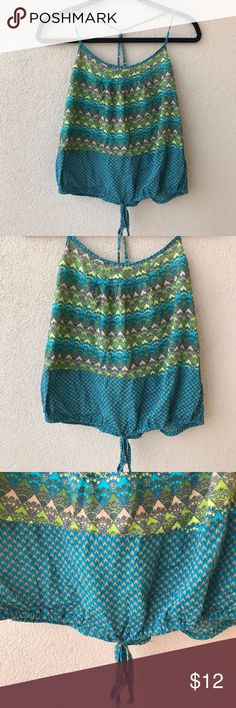 """Mossimo Supply Co. Tie Front Tank Colorful spaghetti strap tank top blouse from Mossimo Supply Co.  This shirt has adjustable straps that cross in the back and an elastic waistband so that you can adjust the bottom hem with beaded tie to make it a longer tank or more crop top style. Excellent used condition.  - Size Medium M - Approx. 16"""" armpit to armpit (but has elastic backband to stretch) - Approx. 15"""" length of bodice (DOESN'T include straps) - 100% cotton  - Closet ID # 0135 Mossimo…"""