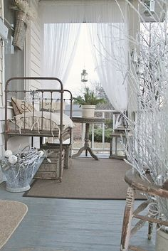 Cottage porch with another daybed fashioned from an antique crib