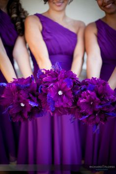 flower and feather bouquets, love the color #purple weddings www.tablescapesbydesign.com https://www.facebook.com/pages/Tablescapes-By-Design/129811416695