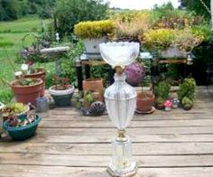 It is easy to make lamp base bird baths by simple using a vintage lamp base that you can pick up at a thrift store cheap, remove the wiring and top it off with a glass light shade, plate or ...